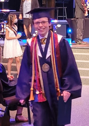 In the same week, Mike Wimmer graduated from both college and high school.