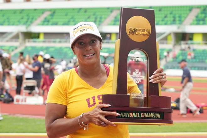 Jun 12, 2021; Eugene, Oregon, USA; Southern California Trojans coach Caryl Smith Gilbert poses with the national women's trophy after the Trojans won the team title during the NCAA Track and Field Championships at Hayward Field. Kirby Lee-USA TODAY Sports