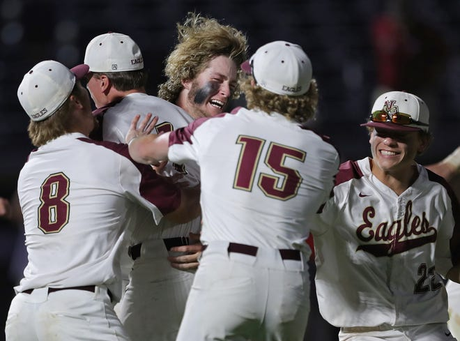 New Albany players celebrate after beating Walsh Jesuit 6-2 on Saturday, June 12, 2021, at Canal Park in Akron, Ohio, to advance to the Division I state title game on Sunday, June 13.