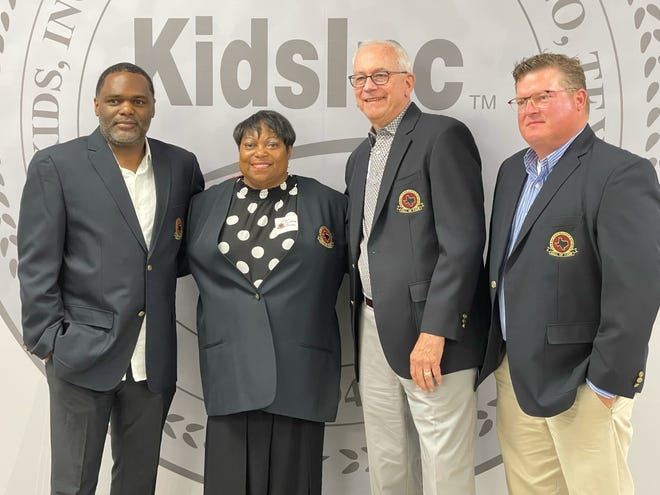 From left: Rayford Young, Sharon Moultrie-Bruner, Joe Lombard and Nick Johnson (brother of Noel Johnson) stand for photos with their Hall of Fame jackets on Saturday at Kids Inc.