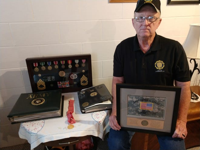 Dave Rohrbaugh, shown posing with some of the awards he received in his nearly 40 years in the military, was recently elected to his seventh term as commander of Loudon Post 257 of the American Legion.