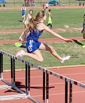 Boonville's Effie Morris competes in the hurdles during the AAU Missouri Valley Track Meet held in Hays, Kansas on Saturday, June 5. Morris, Cash Leonard and Rhodes Leonard are all competing for the Blue Thunder Track Club in Columbia. Morris and Leonards all qualified to move on to the regional track meet in Bentonville, Arkansas on June 25.