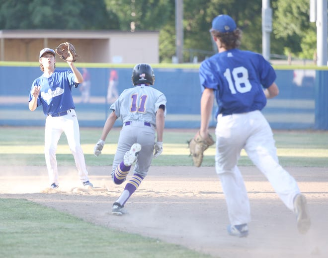 New Franklin first baseman Connor Wilmsmeyer and shortstop Sawyer Felten get Pilot Grove's Hayden Sleeper in a rundown Thursday night in Junior Babe Ruth action at Twillman field in Harley park. New Franklin improved to 2-1 on the season by beating Pilot Grove 4-0.