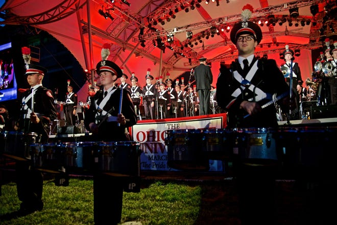 Mmebers of the Ohio State University Marching Band prepared to perform at a previous year's Picnic With the Pops concert with the Columbus Symphony [WILL BRENNER]