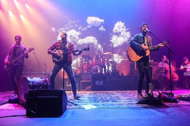 Seth Avett, Scott Avett, Bob Crawford and Joe Kwon with The Avett Brothers perform at the Fox Theatre on Thursday, November 21, 2019, in Atlanta. (Photo by Robb Cohen/Invision/AP)