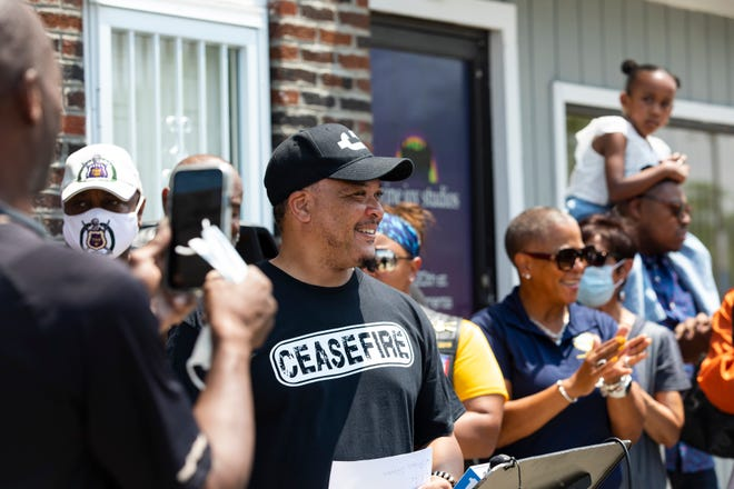 """Al Edmondson speaks outside A Cut Above Barbershop during a news conference Sunday calling for a 24 hour-ceasefire of gun violence on Juneteenth in Columbus. """"As a community we want things to get better and I think that if we do this 24 hour ceasefire it'll make a difference because we can begin to curb the homicides,"""" Edmondson said."""