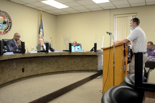 Donaldsonville Fire Chief Adam Gautreaux speaks to the Donaldsonville City Council during the June 8 meeting. Shown from left are Chair Charles Brown, Raymond Aucoin, and Lauthaught Delaney.
