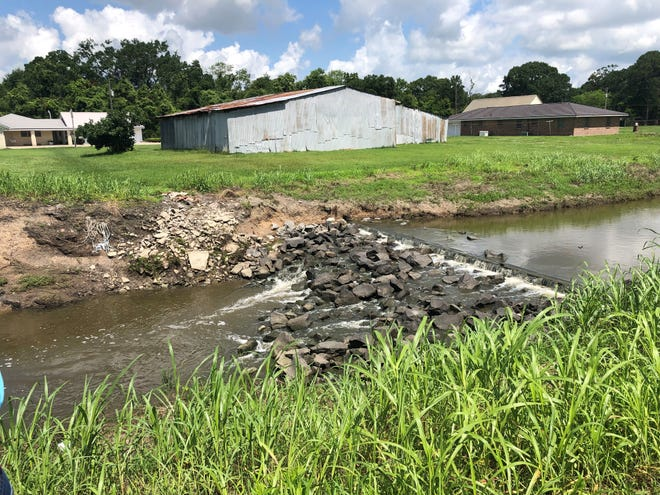 Shown is the weir on west New River at Smith Bayou. The water level in Smith Bayou was three feet below New River on June 9.