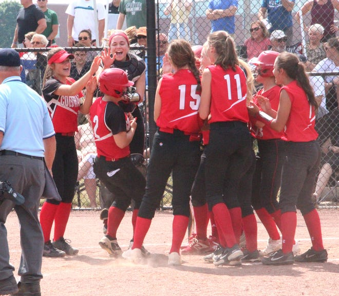 The Lady Cardinals welcome teammate Mia Rzepka home after her solo home run in the sixth inning Saturday
