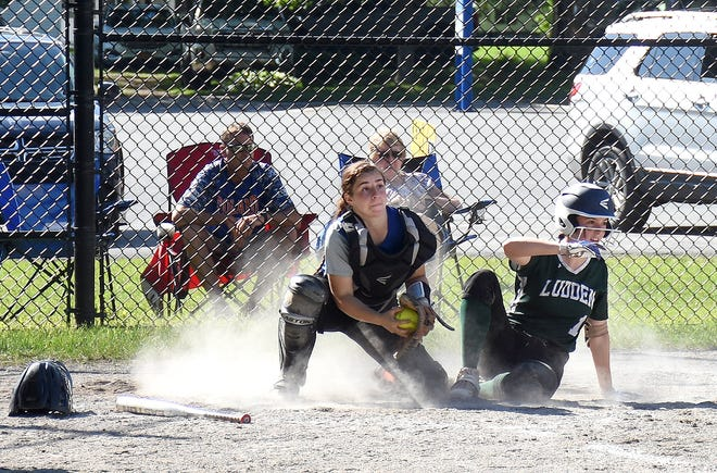Poland catcher Brooke Humiston and Bishop Ludden runner Maryann Sobel (from left) look up for the umpire's call after a play at the plate in Section III's Class D championship softball game Saturday.