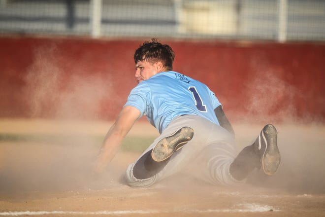 Hutchinson Monarchs infielder Jordan Ardoin slides into home plate during the series finale against the Derby Twins at Hobart-Detter Field Saturday.