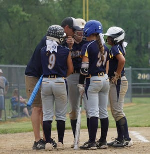 Whiteford coach Matt VanBrandt huddles with his players.