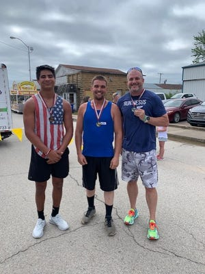 Daniel Goforth, center, was the winner of the 5K run held May 29 in Barnsdall, as an element of the Big Heart Day celebration. Finishing second was Jimmy Shaw, at right. Easton Malone, at left, finished third.
