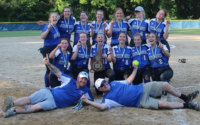 Members of the Oyster River High School softball team pose with the Division II championship plaque following Saturday's 20-7 win over Milford at Rivier University. It was the first championship in program history.
