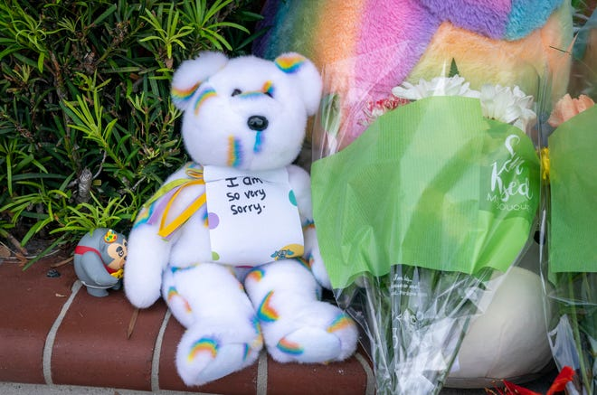 A teddy bear and flowers left at a memorial in front of a Publix Super Market in Royal Palm Beach, Florida on June 13, 2021. Timothy Wall shot and killed a 69-year-old grandmother and her toddler grandson inside the store before killing himself on Thursday. Greg Lovett/The Palm Beach Post
