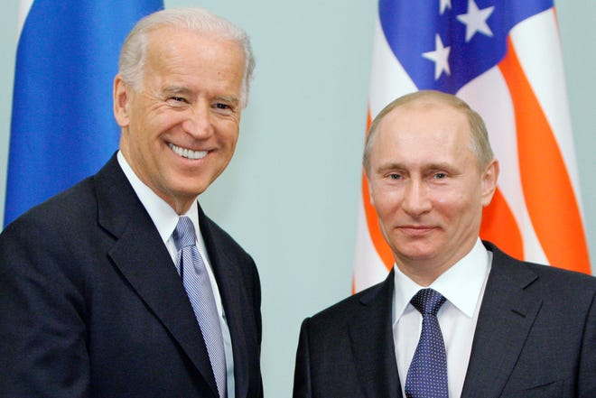 Then-Vice President  Joe Biden, left, shakes hands with Russian Prime Minister Vladimir Putin in Moscow, Russia in 2011. Biden is scheduled to meet with Putin in Geneva on Wednesday.