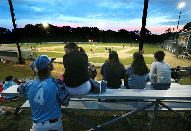 Ocean Waves pitcher Cody Whitten takes some time during a game against Danbury to talk with college friend Colby Berigan of Hingham, Mass., while others take in the game at Old Mountain Field on Friday.