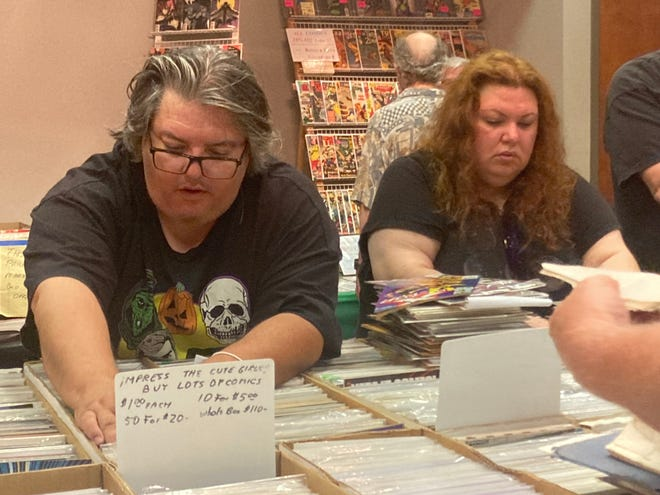 Chris Heady, left, and his girlfriend, Nicole David, search for favorites at the SpringfieldComic BookConvention held at the Route 66 Hotel & Conference Center in Springfield Sunday. It was the first in-person comic book show because of the COVID-19 pandemic since last July.