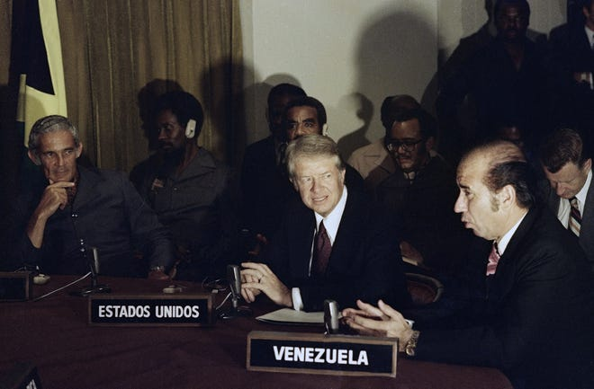 President Jimmy Carter, center, with others while signing Panama Canal Treaty in Panama on June 16, 1978.