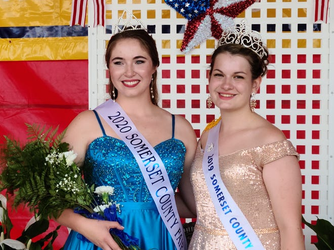 The 2020 Somerset County Fair Queen Abbigail Knapp (left) stands with 2019 queen Chloe Ferko after last year's fair queen contest.