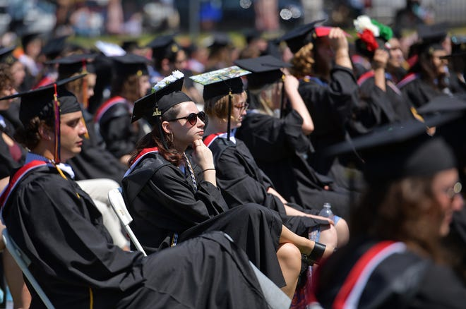 Clark University undergraduates listen to speeches during the college's 117th commencement exercises Sunday at Granger Field.