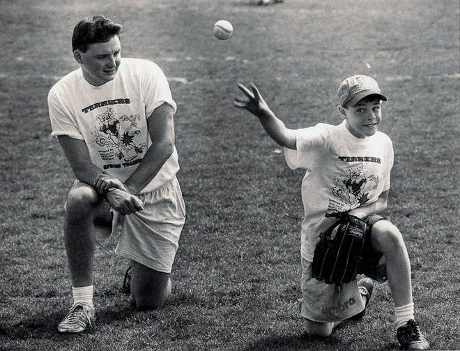 What started as baseball program 30 years ago has evolved into year round, fun focused recreation supporting student wellness. Pictured is Joe Roberts coaching one of his first set of students.