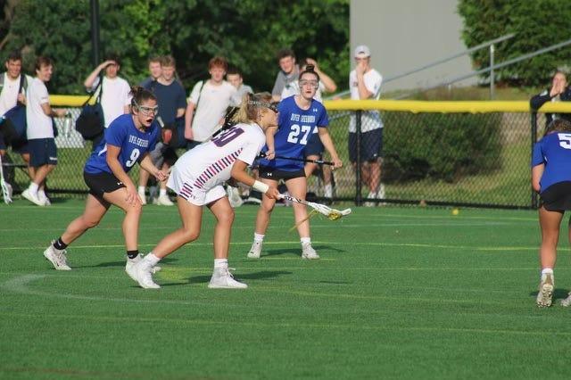 Senior Maggie Jandl takes a free position shot vs Dover-Sherborn