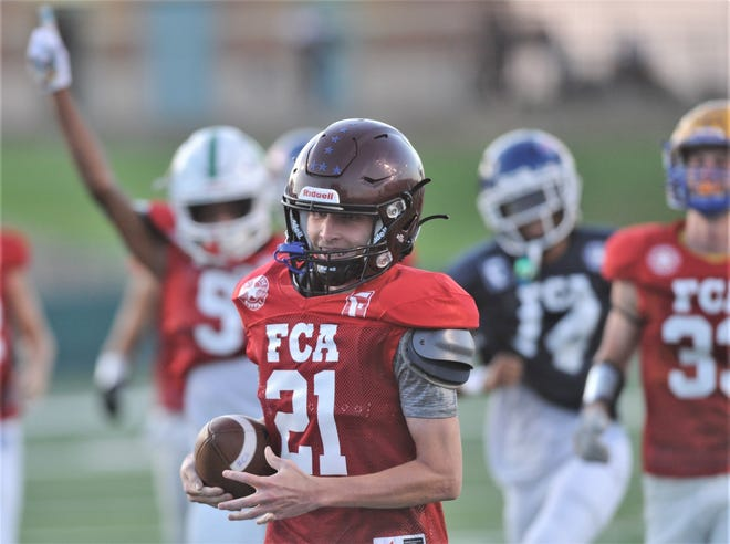 Jonathan Davis smiles as he scores a long touchdown in the annual Big Country FCA Myrle Greathouse All-Star Football Classic at Shotwell Stadium last Saturday.