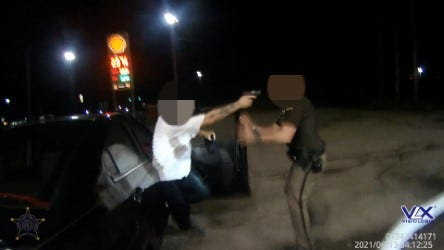 The Boone County Sheriff's Office says this picture shows a man pointing a gun into the face of a deputy.