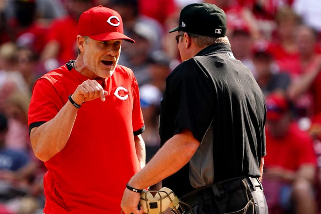 Cincinnati Reds manager David Bell (25) argues home plate umpire Marvin Hudson after Cincinnati Reds left fielder Jesse Winker (33) (not pictured) struck out on what was believed to be a foul tip during the fourth inning of a baseball game, Saturday, June 12, 2021, at Great American Ball Park in Cincinnati. The Cincinnati Reds won, 10-3.
