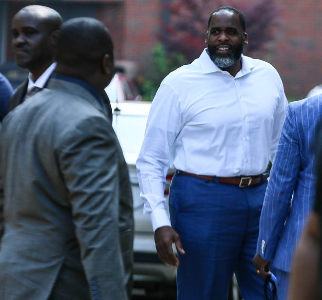 Kwame Kilpatrick, the formerly incarcerated Detroit mayor, is shown June 13,, 2021, headed into the Historic Little Rock Baptist Church in Detroit.