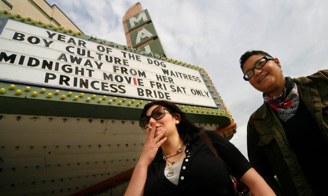 Lauren Furlong, 26, left, takes a puff on her cigarette before heading into the Main Art Theatre, in Royal Oak with her girlfriend Jodi Laney, 24, both from Detroit, Friday evening May 25, 2007.