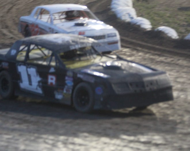 Robert Petroff of Bozeman, driving the No. 11 car, begins his victory lap after winning the WISSOTA Street Stocks final Saturday night at Electric City Speedway. It marked the six time this season Petroff has won on a Montana track.
