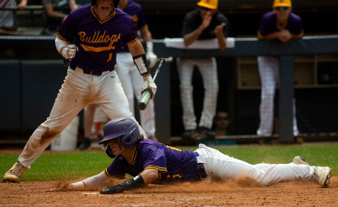 Bloom-Carroll's Ayden Anderson (16) slides into home against Akron Archbishop Hoban during the Division II State Finals Baseball at Canal Park in Akron, Ohio on June 13, 2021. Archbishop Hoban defeated Bloom-Carroll 2-1 in the tenth inning.