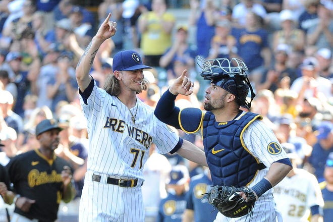 Brewers closer Josh Hader celebrates with catcher Manny Pina after putting down the Pirates for his 17th save of the season.