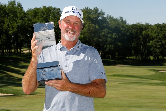 Madison's Jerry Kelly holds the American Family Insurance Championship trophy on Sunday. Kelly also won the event in 2019.