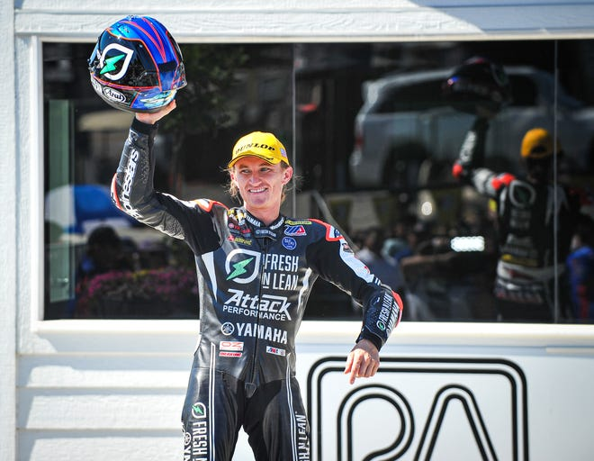 Superbike race winner Jake Gagne acknowledges the cheers during podium ceremonies after the finale at the MotoAmerica Superbikes at Road America weekend Sunday at Road America.