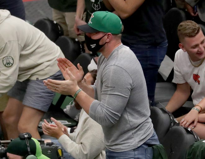 Pewaukee native J.J. Watt cheers on the Milwaukee Bucks during the second quarter of their Eastern Conference semifinal playoff game against the Brooklyn Nets at Fiserv Forum in Milwaukee on Sunday, June 13, 2021.