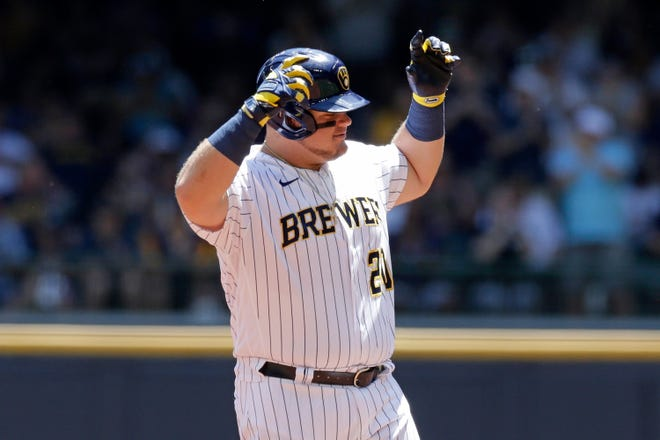 Daniel Vogelbach gestures toward the Brewers dugout after smacking an RBI double in the first inning against the Pirates.