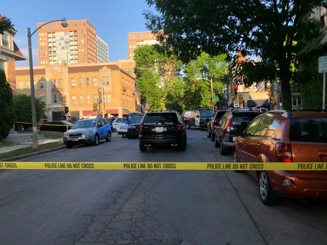 Emergency vehicles respond to the corner of North Farwell Avenue and East Lafayette Place for a shooting Saturday evening. Milwaukee police say a 25-year-old man shot a 21-year-old woman before killing himself. The woman suffered life-threatening injuries.