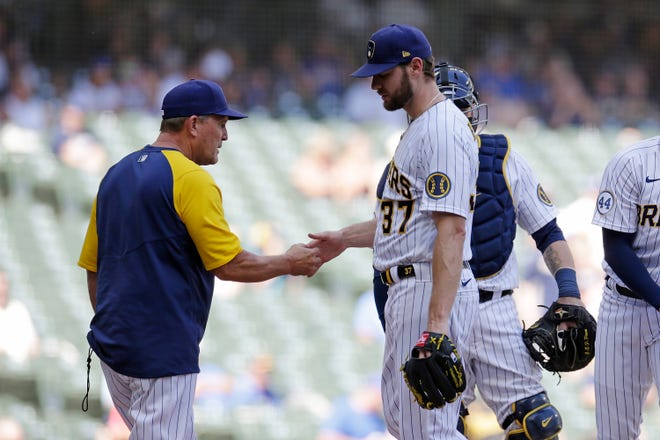 Pat Murphy, filling in Sunday for Brewers manager Craig Counsell, takes Adrian Houser out of the game in the sixth inning against the Pirates at American Family Field.