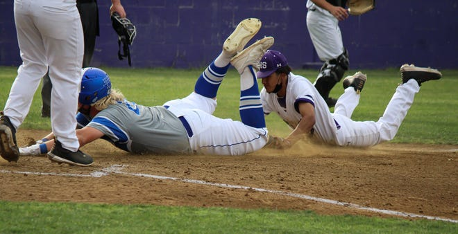 Carlsbad's Kayden Bratcher is tagged out by Clovis' Anthony Garcia out while he slides into home base on June 11, 2021. Carlsbad swept the season series.