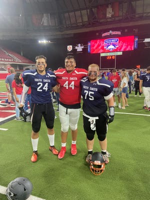 Coby Maeschen (left), Ashaun Roach-Valandra and Zach Schreier participated in the South Dakota All-Star game at the Dakota Dome on Saturday, June 12, 2021.