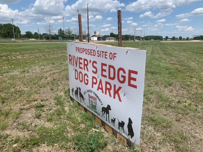 A sign identifies the sight of the proposed new dog park in Dell Rapids. Rickeman Field is in the background.
