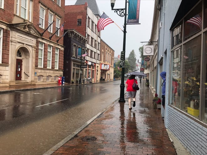 Rain covers half of the east end of Beverley Street in Staunton on June 13, 2021.