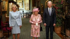 Queen Elizabeth II with Joe and Jill Biden in the Grand Corridor during a visit to Windsor Castle on June 13, 2021, in Windsor, England.