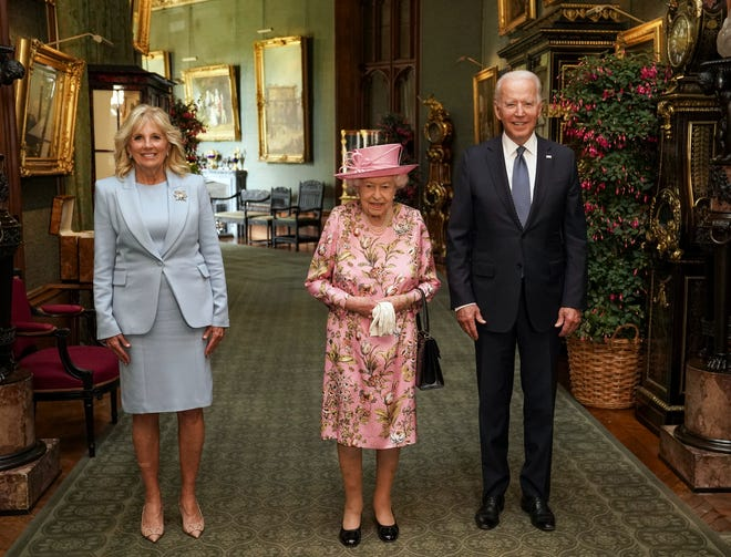 Queen Elizabeth II with Joe and Jill Biden in the Great Hall during a visit to Windsor Castle on 13 June 2021 in Windsor, England.