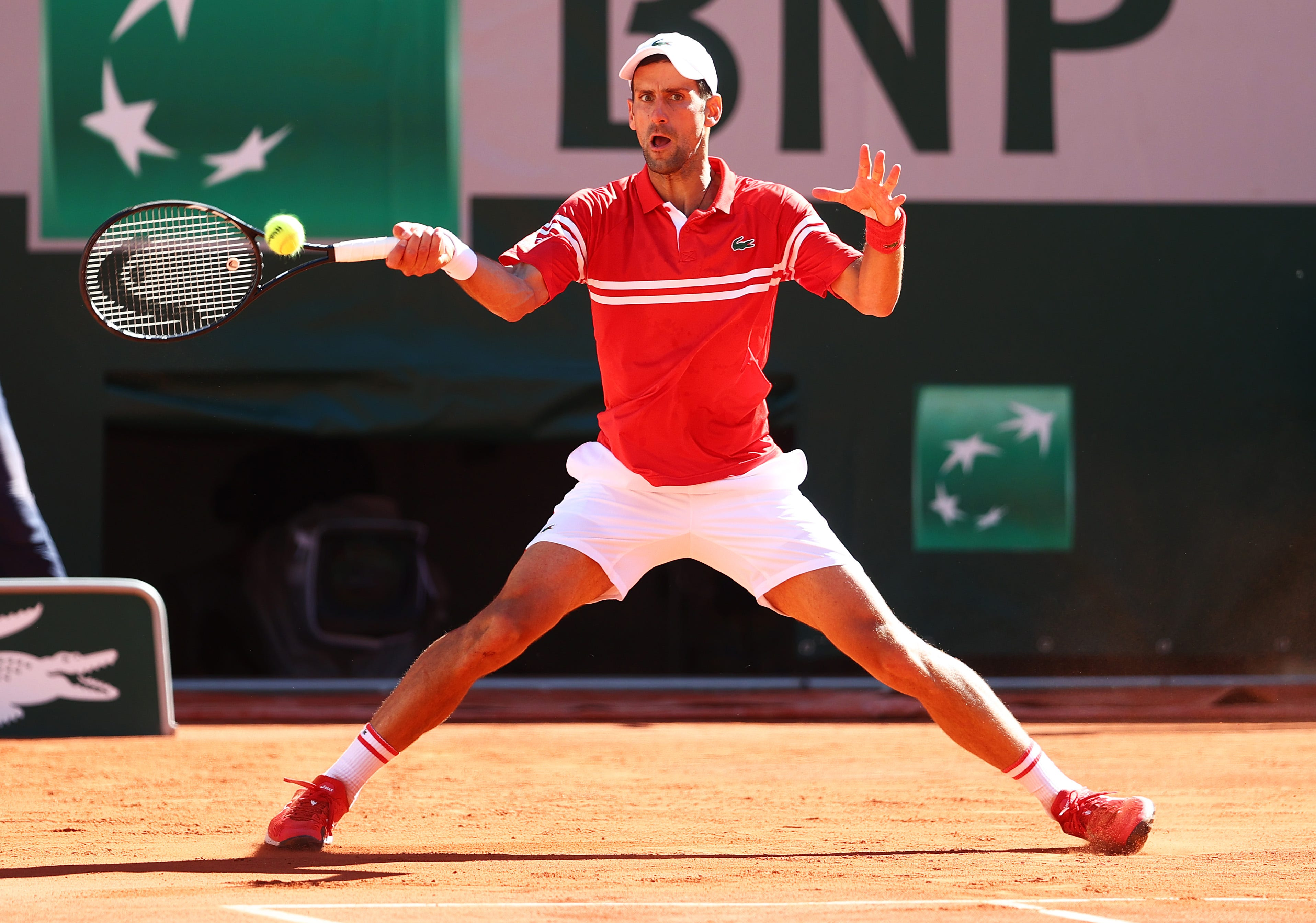 Novak Djokovic storms back to win French Open men's title in five sets