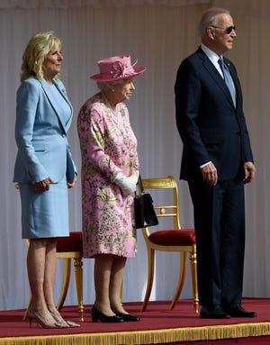 Britain's Queen Elizabeth II, center, stands with U.S. President Joe Biden and first lady Jill Biden at Windsor Castle near London on June 13, 2021.