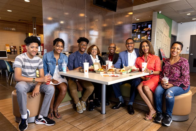 Three generations of the Ross family eat at one of their McDonald's restaurants in North Austin. Grandparents Ann and Winston Ross started the family restaurant business. Around the table are, from left, Roman, Ryan Elizabeth, Little Winston, Ann, Winston, E.W., Heather and Erica.